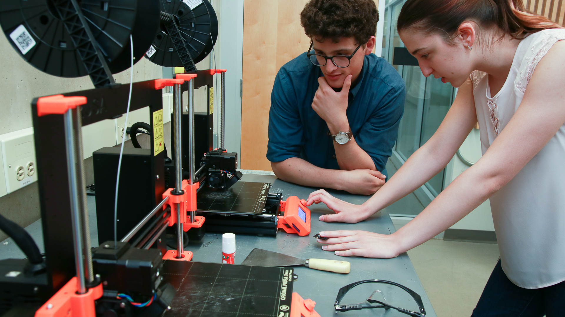 Students awaiting a 3D print